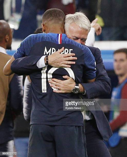 France coach Didier Deschamps hugs Kylian Mbappe after their team defeated Belgium 10 in the World Cup semifinals in St Petersburg on July 10 2018...