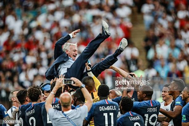 France coach Didier Deschamps is thrown in the air during the 2018 FIFA World Cup Russia Final between France and Croatia at Luzhniki Stadium on July...