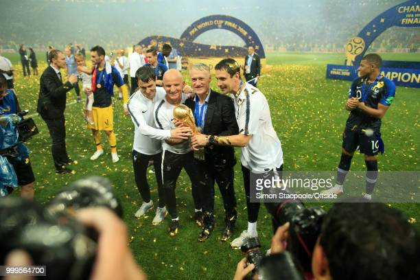 France coach Didier Deschamps poses with the trophy after the 2018 FIFA World Cup Russia Final between France and Croatia at the Luzhniki Stadium on...