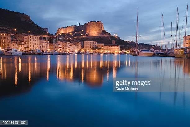 France, Corsica, Bonifacio, marina and Bastion de l'Etendard at dusk