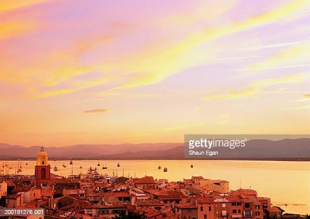 france, cote d'azur, st tropez, town and bay, dusk - st tropez stock pictures, royalty-free photos & images