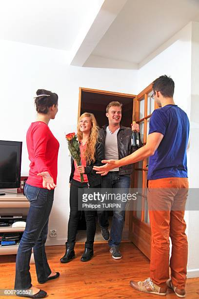 France, couple receiving friends arriving with gifts