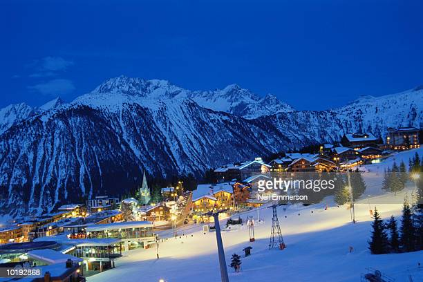 france, courchevel, ski resort at dusk, elevated view - courchevel stock pictures, royalty-free photos & images