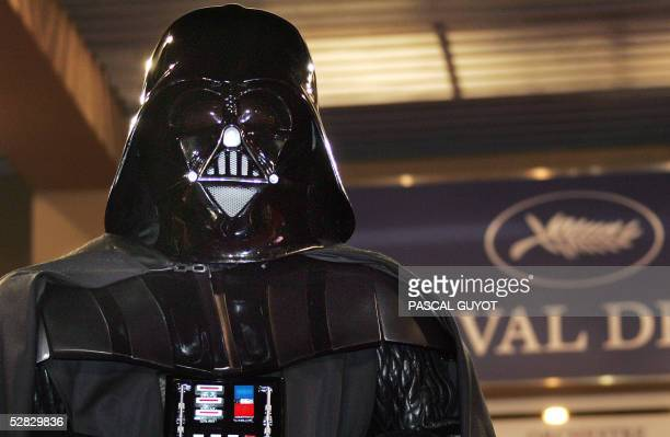 Darth Vader poses for photographers at the end of the screening of US director George Lucas' film 'Star Wars Episode III Revenge of the Sith' 15 May...