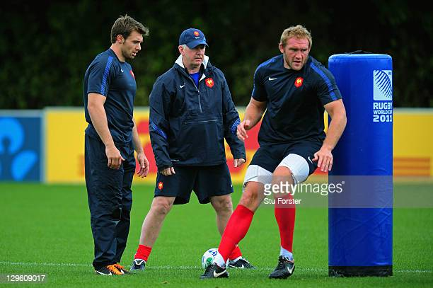 France defence coach Dave Ellis looks on as Wing Vincent Clerc and lock Romain Millo-Chluski run through drills during a France IRB Rugby World Cup...