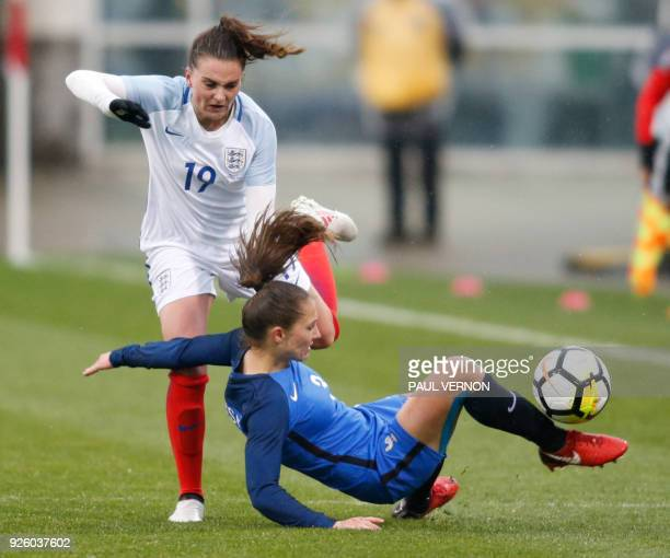 France defender Eve Perisset clears the ball against England forward Mel Lawley during the second half of a SheBelieves Cup match at Mapfre Stadium...