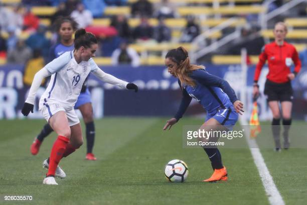 France defender Sakina Karchaoui controls the ball along the sideline as England forward Mel Lawley defends during the second half of the...