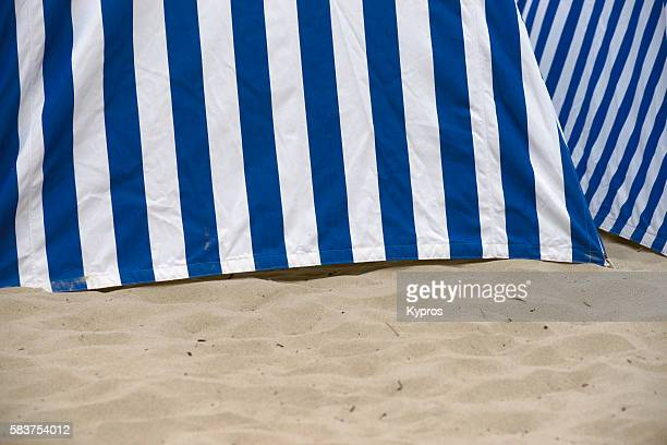 france, dinard, traditional blue and white striped tents on the beach - dinard stock pictures, royalty-free photos & images