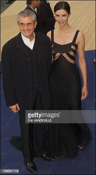 France director Claude Lelouch and his wife France actress Alessandra Martines in Venice Italy on September 6th 2003
