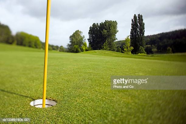 france, dordogne, golf hole with flag pole - golf flag stock pictures, royalty-free photos & images