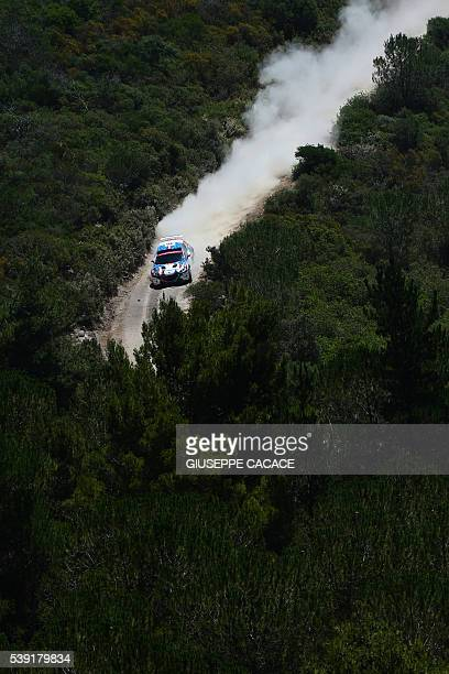 France driver Giordano Quentin and codriver Thierry Salva steer their Peugeot 208T16 R5 near Castelsardo on the second day of the 2016 FIA World...