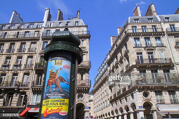 France Europe French Paris 2nd arrondissement Rue du 4 September billboard bulletins theatre Morris column cylindrical advertising
