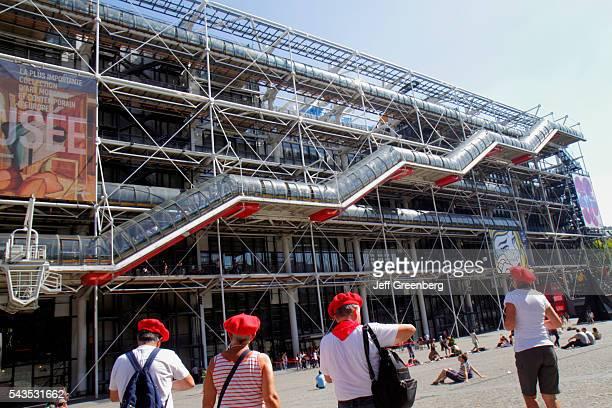 France Europe French Paris 4th arrondissement Centre Georges Pompidou center front outside entrance man woman chapeau hat red