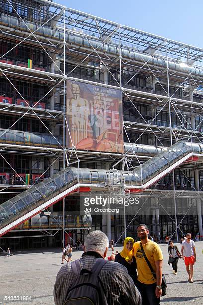 France Europe French Paris 4th arrondissement Centre Georges Pompidou center front outside entrance Muslim man woman couple posing
