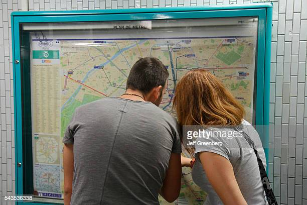 France Europe French Paris 5th arrondissement Cluny La Sorbonne Station Line 10 subway public transportation man woman couple looking at map