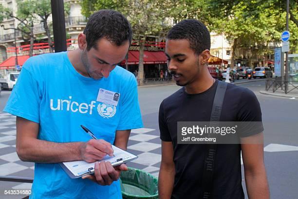 France Europe French Paris 5th arrondissement Latin Quarter Rive Gauche Left Bank Boulevard SaintGermain taking survey Unicef