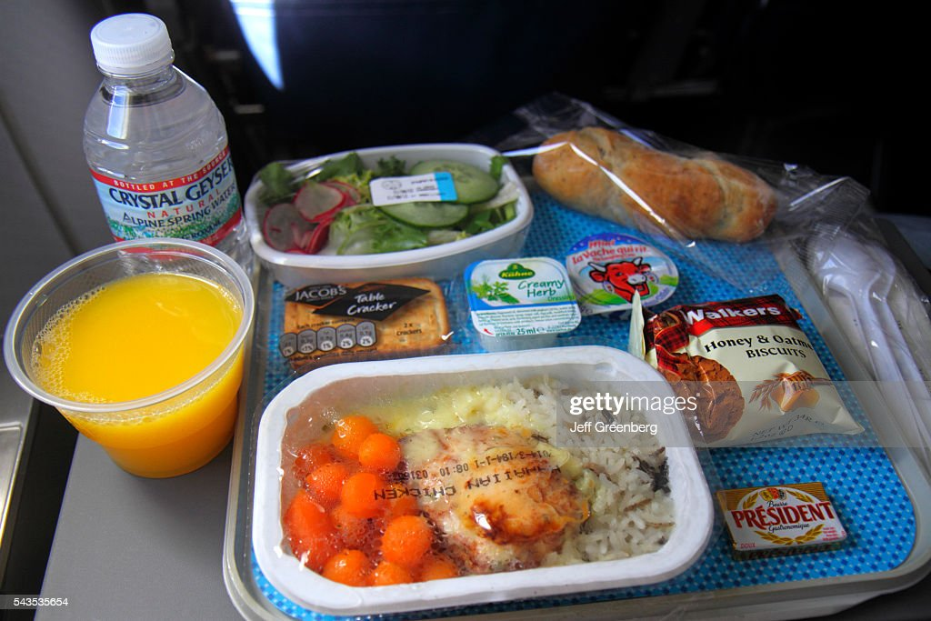 Paris, Charles de Gaulle Airport American Airlines economy seat in-flight meal orange juice : News Photo