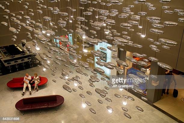 France Europe French Paris CDG Charles de Gaulle Airport terminal concourse gate area mobile art chandelier