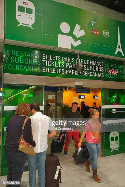 France Europe French Paris CDG Charles de Gaulle Airport ticket office train RER Metro SNCF RATP man woman couple public transportation