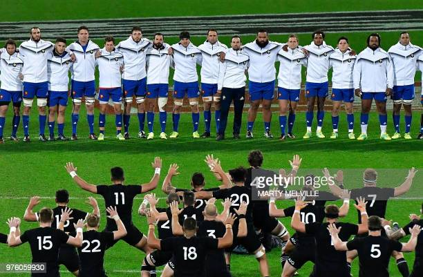 TOPSHOT France face New Zealand's players as they perform the 'haka' at the start of the second rugby Test match between New Zealand and France at...