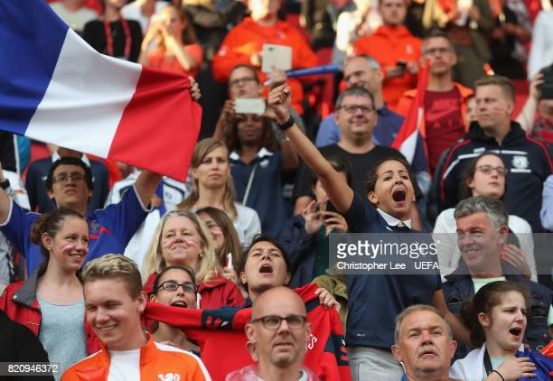 France fan bellows out the French national anthem during the UEFA Women's Euro 2017 Group C match between France and Austria at Stadion Galgenwaard...