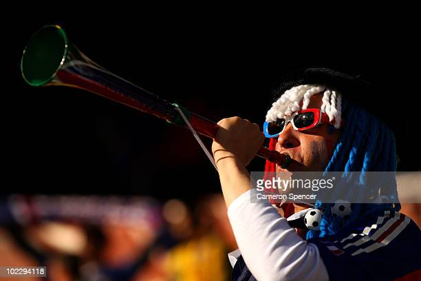 France fan blows a vuvuzela prior to the 2010 FIFA World Cup South Africa Group A match between France and South Africa at the Free State Stadium on...