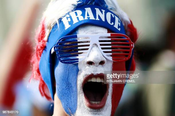 A France fan cheers before the Russia 2018 World Cup round of 16 football match between France and Argentina at the Kazan Arena in Kazan on June 30...
