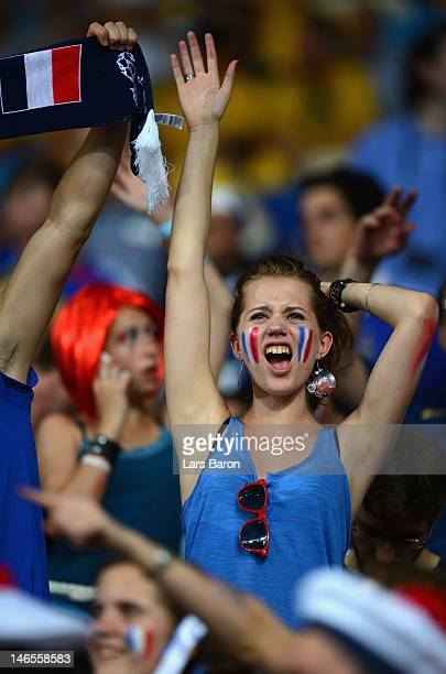 France fan cheers during the UEFA EURO 2012 group D match between Sweden and France at The Olympic Stadium on June 19 2012 in Kiev Ukraine