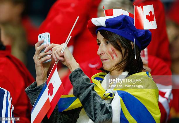 France fan takes a photograph prior to the 2015 Rugby World Cup Pool D match between France and Canada at Stadium mk on October 1 2015 in Milton...