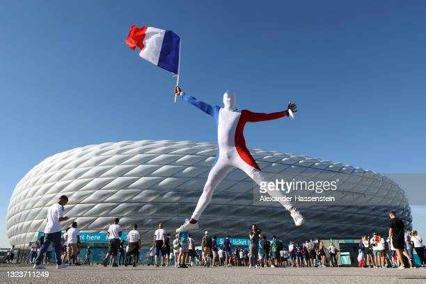 France fan wearing a skin suit poses for a photo outside the stadium prior to the UEFA Euro 2020 Championship Group F match between France and...