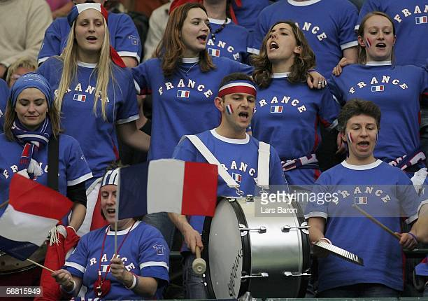 France fans celebrate during the men's single match between Nicolas Kiefer of Germany and Sebastien Grosjean of France at the Davis Cup World Group...