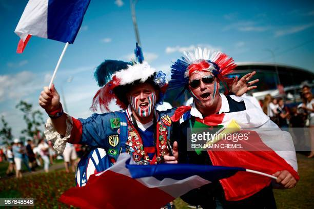 TOPSHOT France fans cheer before the Russia 2018 World Cup round of 16 football match between France and Argentina at the Kazan Arena in Kazan on...