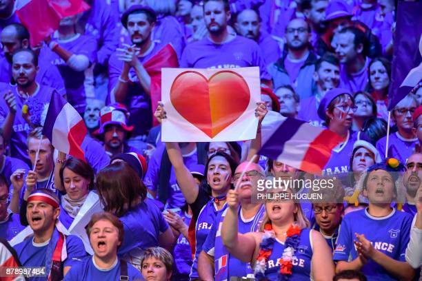 France fans cheer during the doubles tennis match at the Davis Cup World Group final between France and Belgium at Pierre Mauroy Stadium in Lille on...