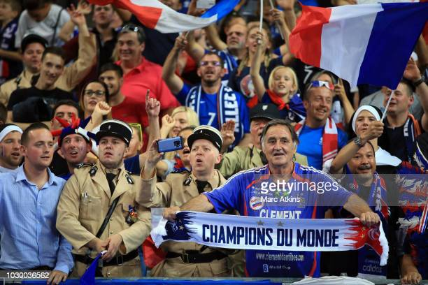 "France fans including a pair dressed Gendarme from the film ""The Gendarme of Saint-Tropez"" during the UEFA Nations League A group one match between..."