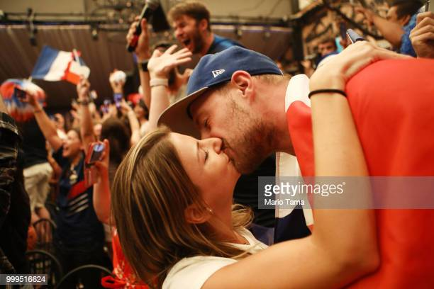 France fans kiss while celebrating at a French watch party at Liasion restaurant in Hollywood after France defeated Croatia in the World Cup final on...