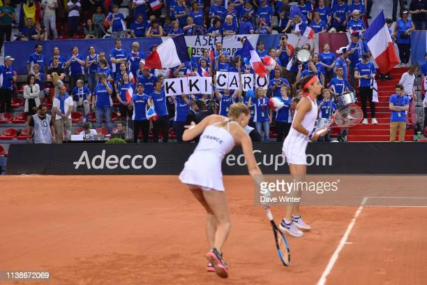 France fans of Kristina Mladenovic of France and Caroline Garcia of France watch them warm up before the Fed Cup semifinal between France and Romania...