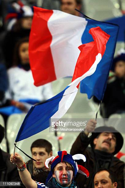 France fans show their colours during the International friendly match between France and Croatia at Stade de France at Stade de France on March 29...