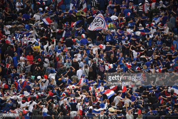 France fans show their support during the 2018 FIFA World Cup Russia Semi Final match between Belgium and France at Saint Petersburg Stadium on July...