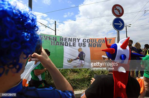 France fans take photos of Irish flag with a picture of the Thierry Henry handball before the UEFA EURO 2016 Round of 16 match between France and...