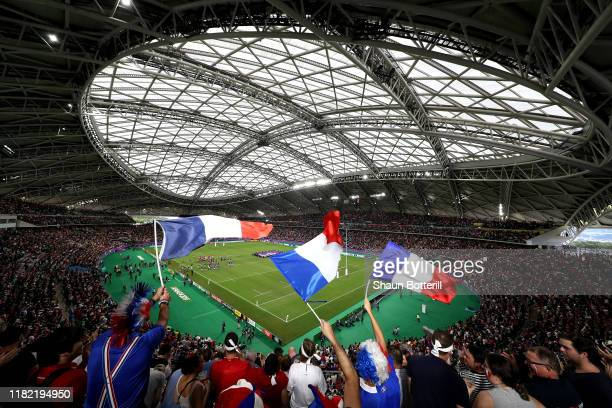 France fans wave flags inside the stadium prior to the Rugby World Cup 2019 Quarter Final match between Wales and France at Oita Stadium on October...