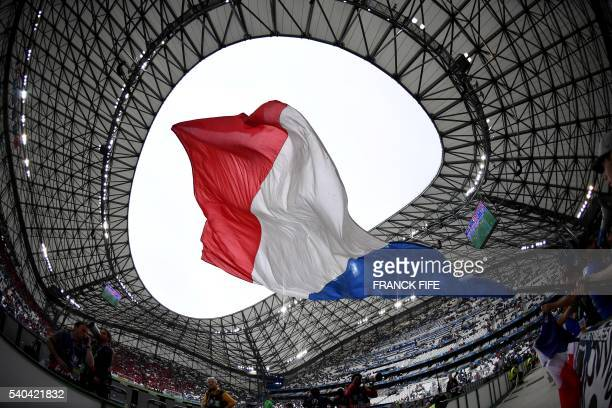 France fans wave the national flag as they wait for the start of the Euro 2016 group A football match between France and Albania at the Velodrome...