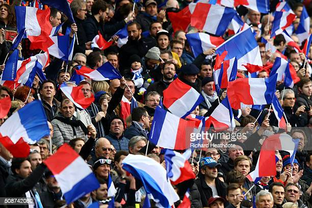 France fans wave the national flag during the RBS Six Nations match between France and Italy at Stade de France on February 6 2016 in Paris France