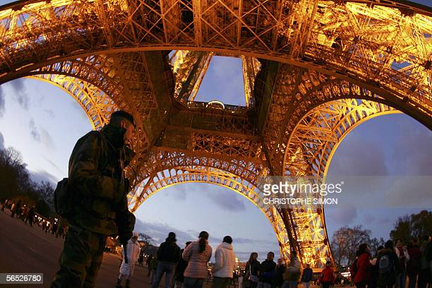 FILES A picture taken 25 December 2005 shows French soldiers patroling around Paris' Eiffel tower illuminated on christmas evening As German...