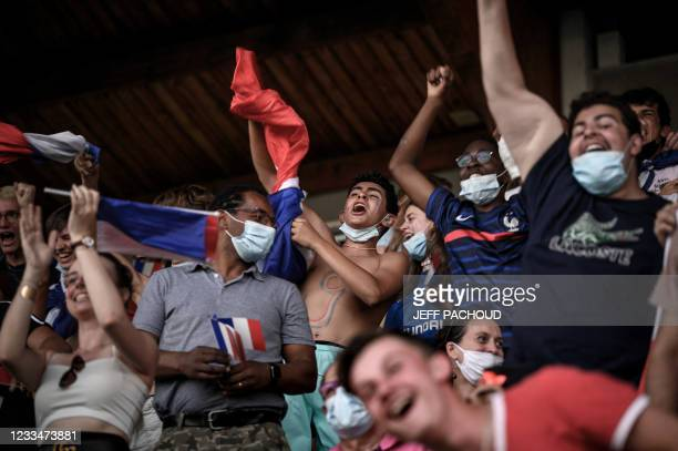 France football supporters react following a goal during the UEFA EURO 2020 Group F football match in Munich, between France and Germany, on June 15...