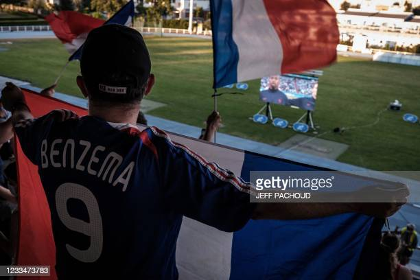 France football supporters watch the UEFA EURO 2020 Group F football match in Munich, between France and Germany, on a large screen on June 15 at the...