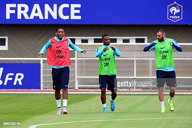 France forward Anthony Martial defender Patrice Evra and forward Karim Benzema during a training session at the French national football team centre...