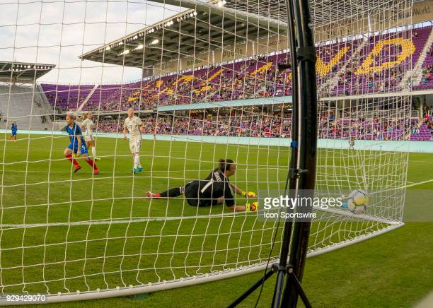 France forward Eugénie Le Sommer scores a goal vs Germany goalkeeper Almuth Schult during the SheBelieves Cup between Germany and France on March 7th...