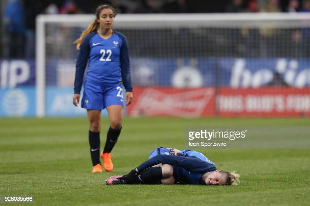 France forward Faustine Robert holds her ankle after being injured during the second half of the international game between England and France...