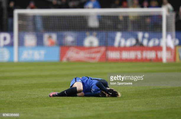 France forward Faustine Robert lays on the field injured as play goes on during the second half of the international game between England and France...