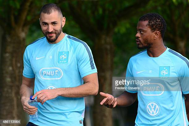 France forward Karim Benzema and defender Patrice Evra arrive a training session at the French national football team centre in...